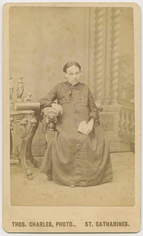 "CDV, Older Woman ""Annie"" seated taken by Thos. Charles, St. Catharines. Thos.  CHARLES, Annie , photographer, subject."