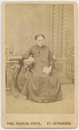 "CDV, Older Woman ""Annie"" seated taken by Thos. Charles, St. Catharines. Thos CHARLES, subject, photographer, Annie."
